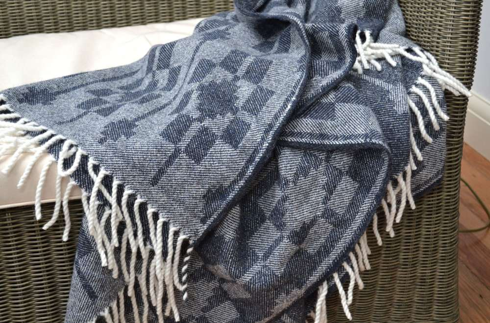 Handwoven 'Dukagang' throw on chair