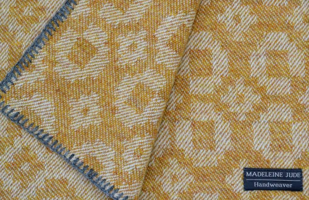 Ochre lambswool 'Classic Squares' throw