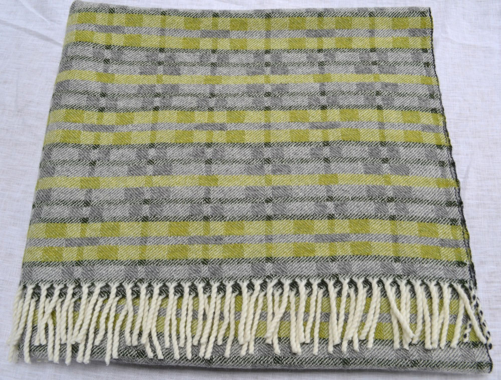 Handwoven 'Dukagang Stripe' lambswool throw in apple green, mid grey and dark green