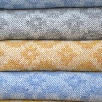 A stack of throws in the 'Classic Squares' design