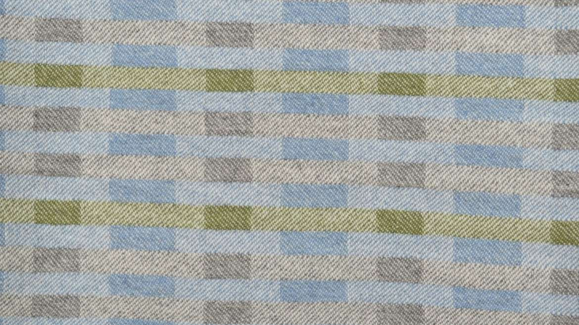 Lineal throw in blue, grey and green